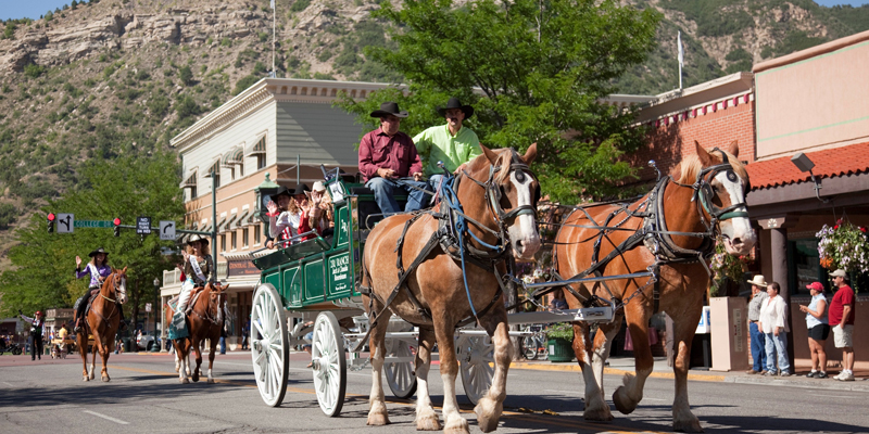 Picuter of Durango Main St Summer time.  Horse drawn wagon