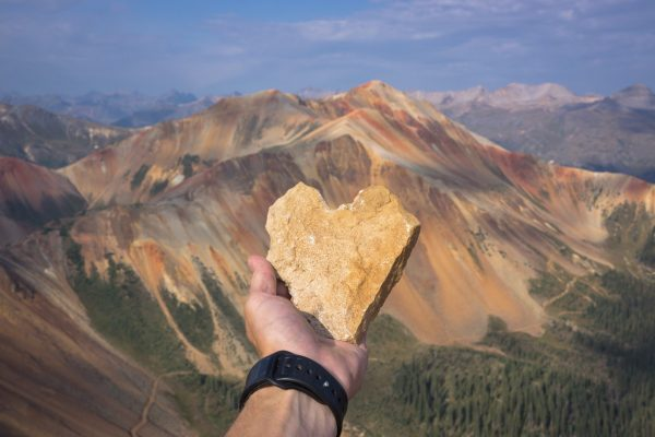 Heart Shaped Rock in front of mountains